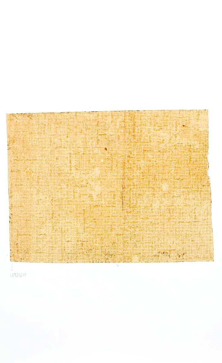 Tapetprov  med tryckt mönster, melerat i grönt, gult och rosa. Kartongen är numrerad på baksidan: 172 2.