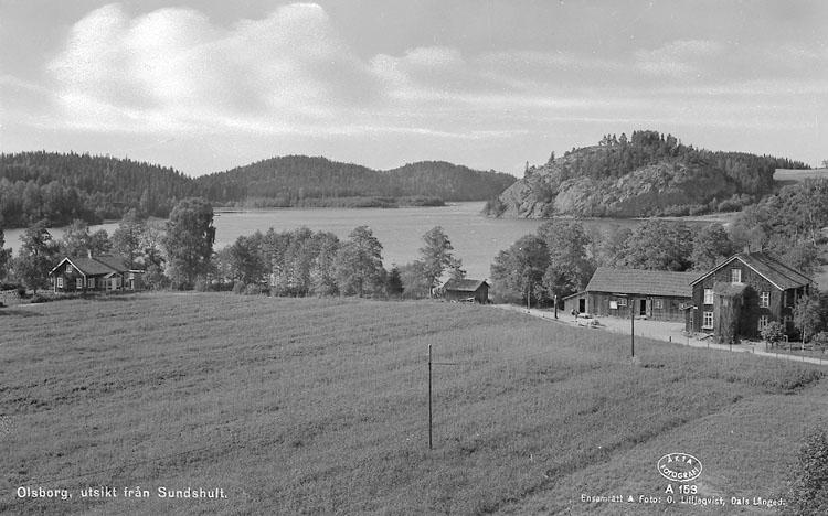 """Enligt AB Flygtrafik Bengtsfors: """"Bullaren Sundshult O & S Helgen E."""". Enligt text på fotot: """"Olsborg, utsikt från Sundshult""""."""