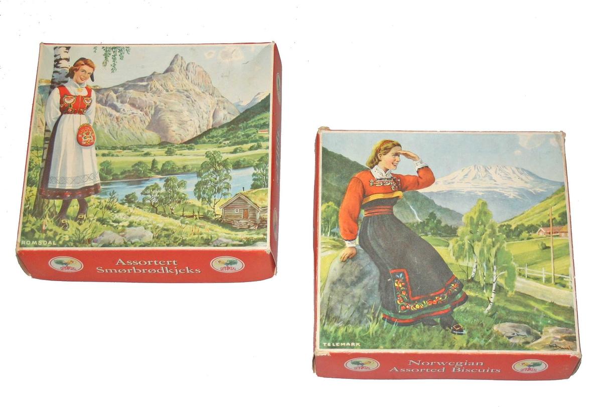 Kjeksembalasje/øskjer med motiv av bunadsjenter i norsk landskap.  Bunadsmotiv: Romsdal og Telemark