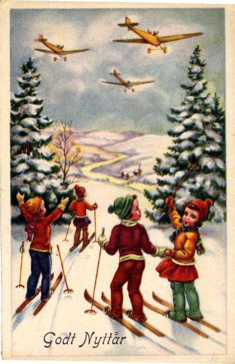 """Prospetkort. Fire barn på ski i en skog. De ser på tre fly i luften. Nederst står det """"Godt Nyttår""""."""