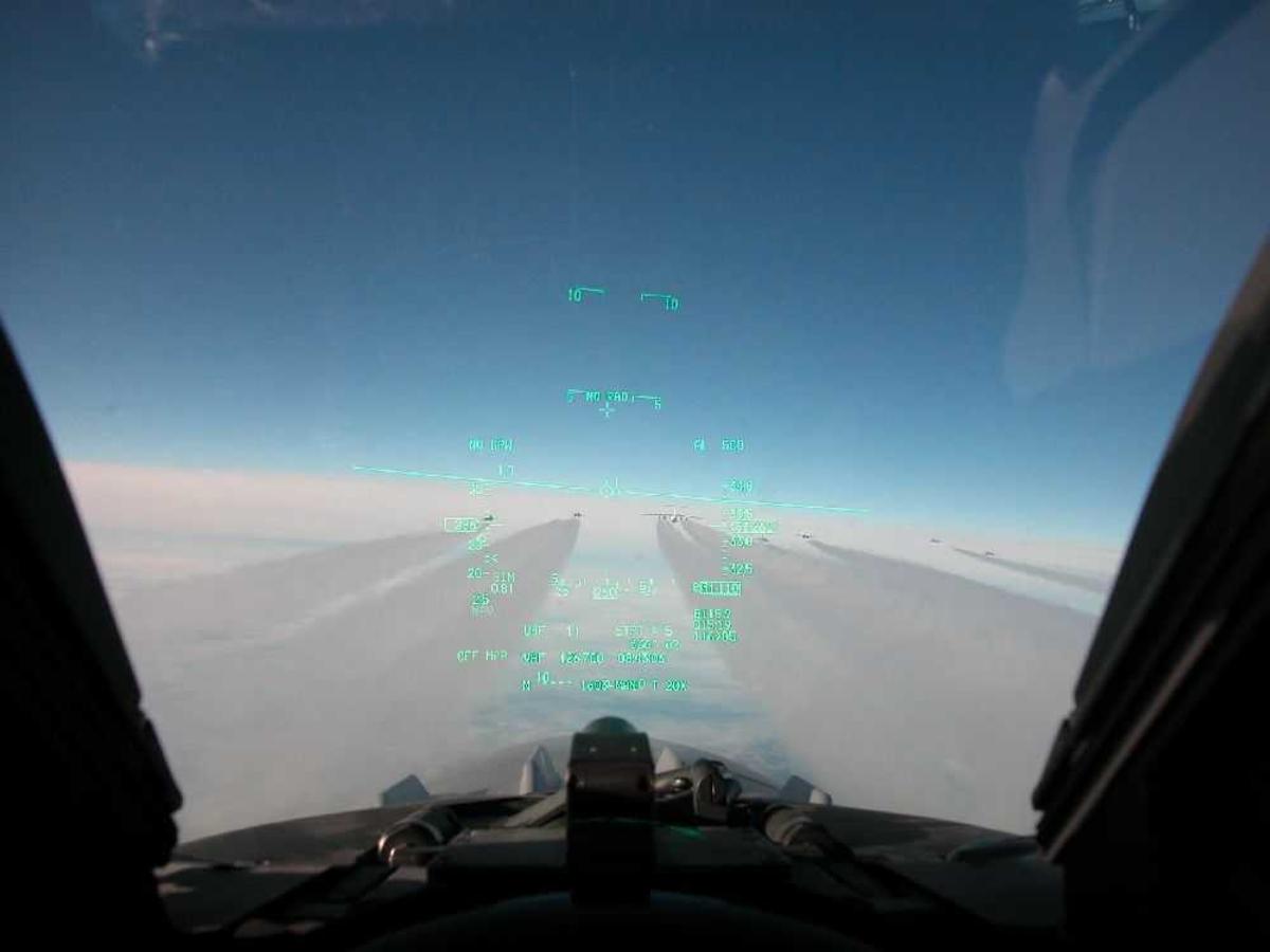 Luftfoto. Utsikt fra vindu i cockpit.