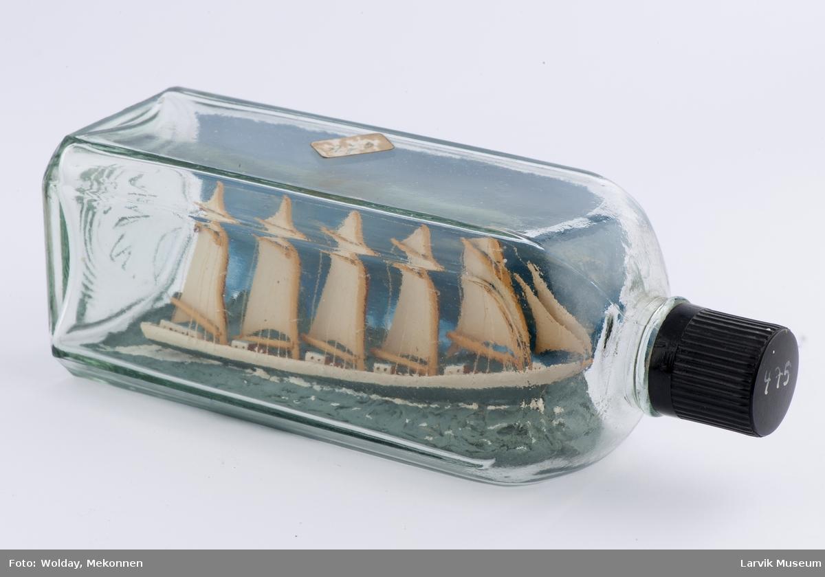 Slettoppermodell i flaske