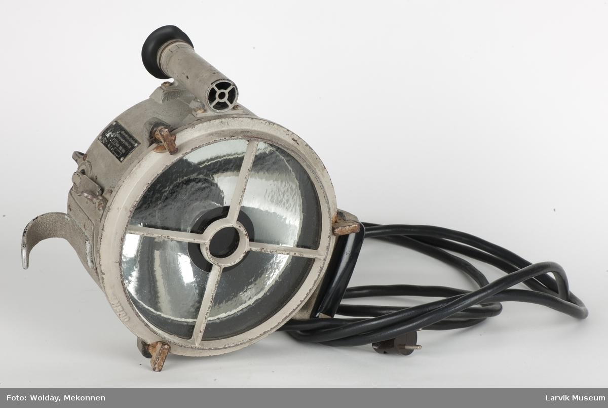 Signallampe i trekasse, m. sikte og el. ledning Form: Sylinderformet