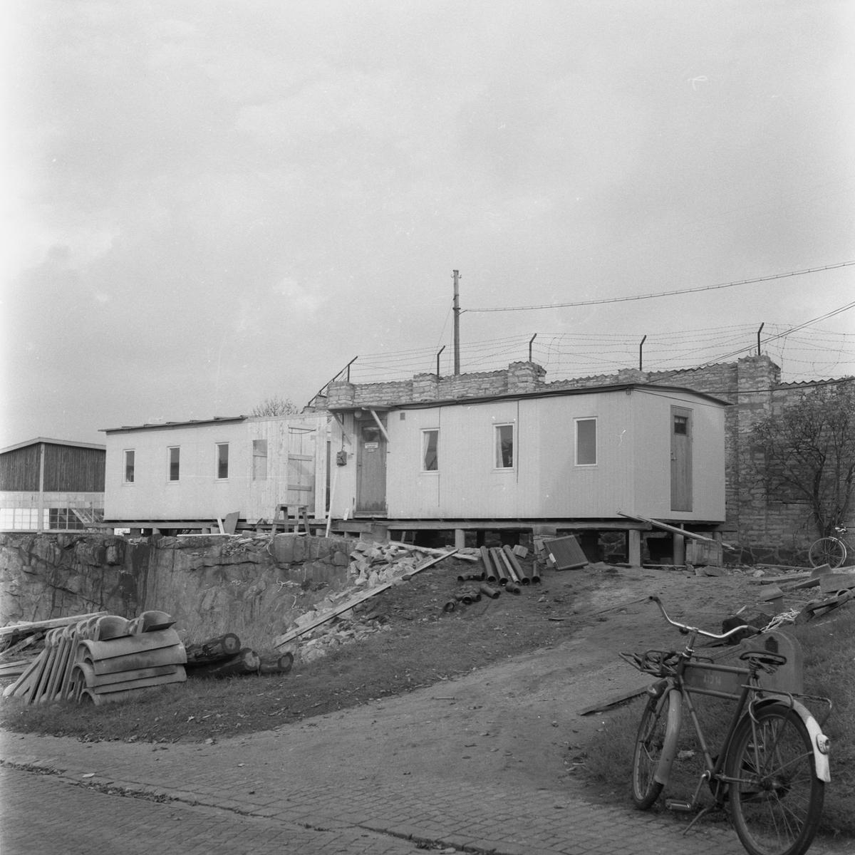 Övrigt: Fotodatum:8/10 1958 Byggnader och Kranar. Rivning av maskranen ext o int på g:a kajen vid maskinverket.