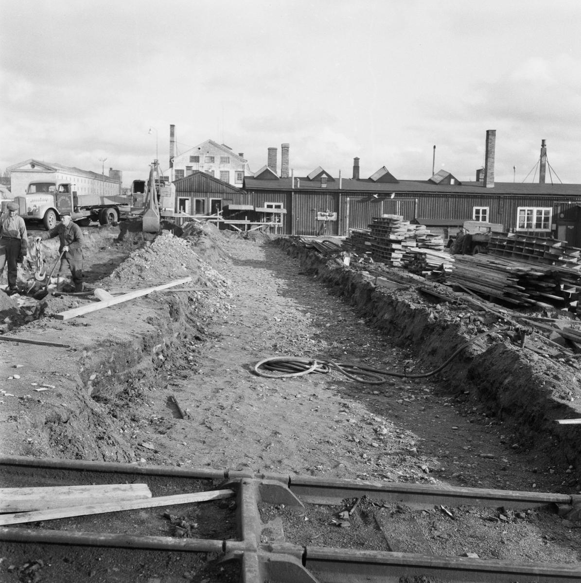 Övrigt: Fotodatum:30/10 1959 Byggnader och Kranar. Slipen spåromläggning
