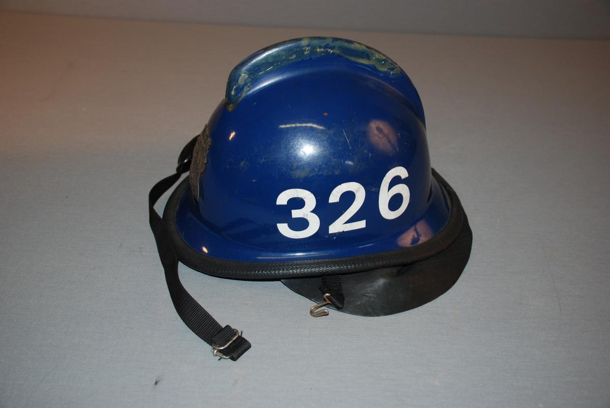 Bergen byvåpen - merke i metall på hjelmens front.