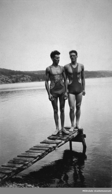 Två män på en brygga ev. vid Tulebosjön, cirka 1930.