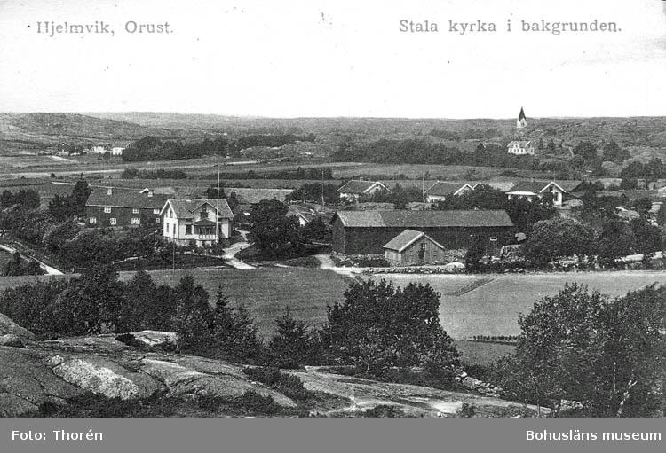 """Text på kortet:""""Hjelmvik, Orust""""."""