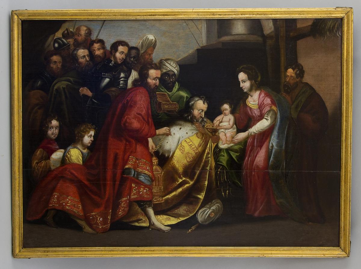 Tavla föreställande de tre vise mänen som lämnar gåvor till Jesusbarnet. Vid sidan står Maria och Josef. I bakgrunden en folksamling med bl.a. soldater.