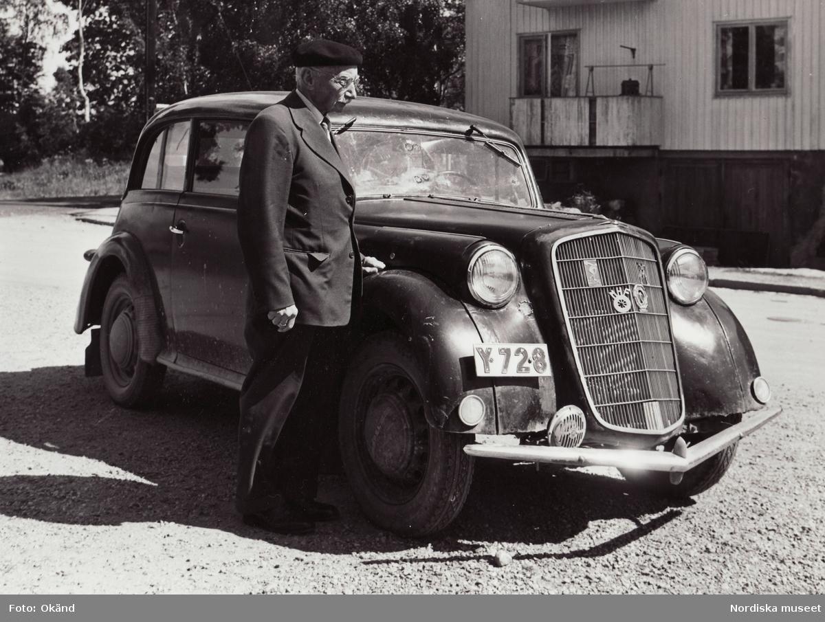 """General Motors Nordiska Ab. """"En äldre herre med sin trotjänande Opel Olympia."""""""