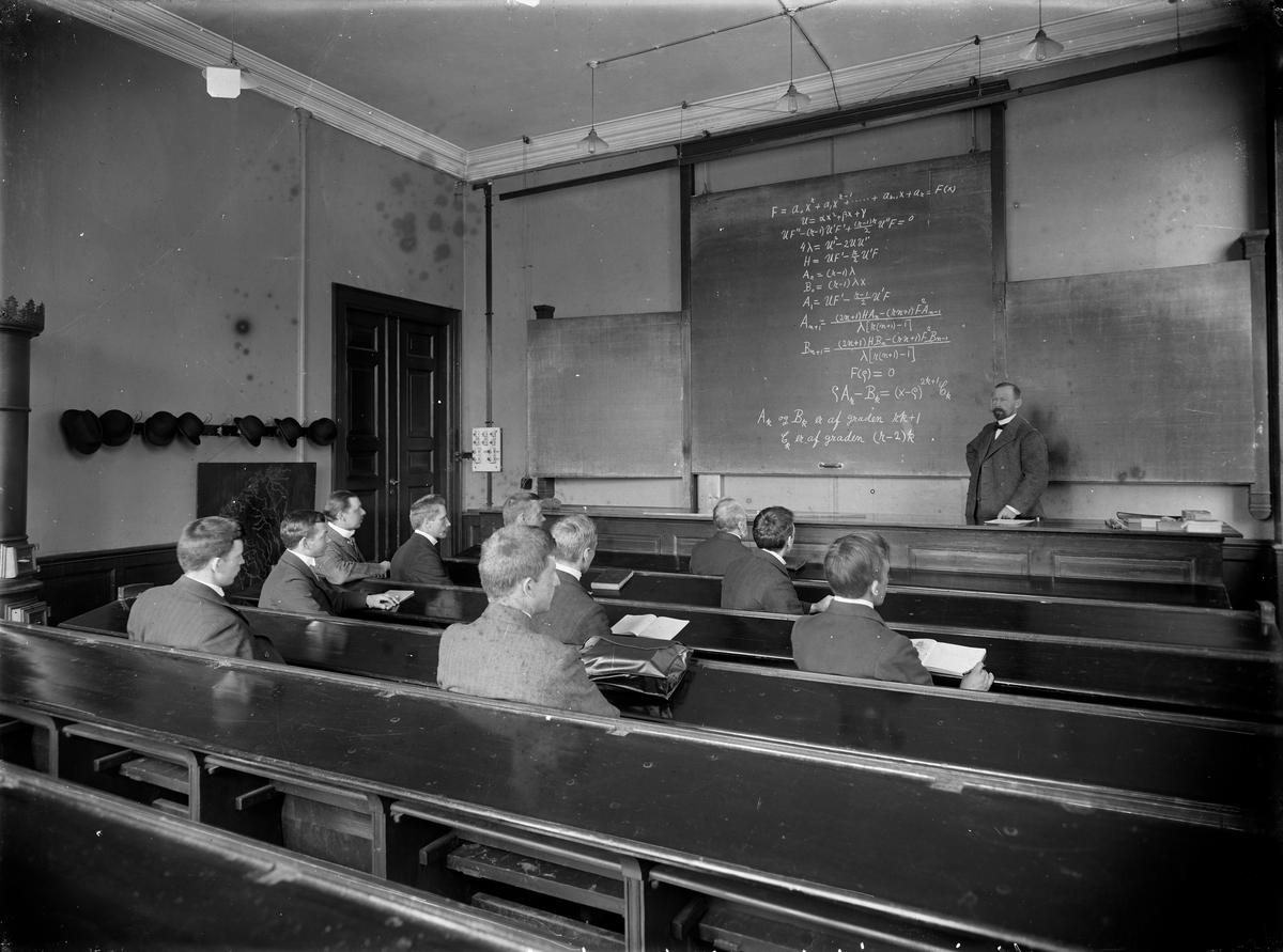 Undervisingsrom med studenter og foreleser