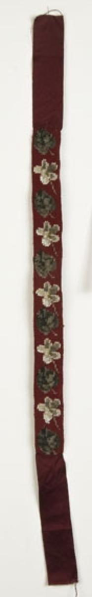 Blankt sløyfebånd i ull med perlebroderier. Broderier danner 6 blader og 5 blomster
