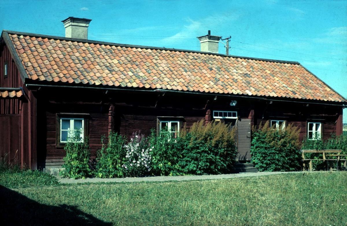 Skuttungestugan på friluftsmuseet Disagården, Gamla Uppsala