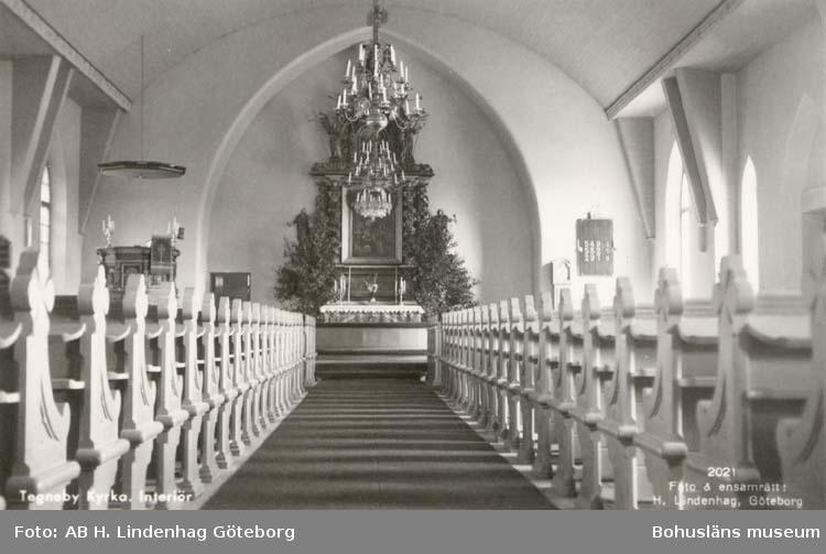 """Tryckt text på kortet: """"Tegneby kyrka. Interiör. """" ::"""