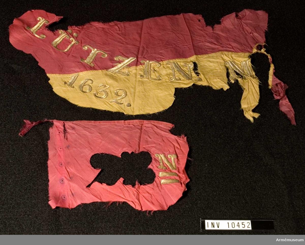 Grupp B.  Duk av rött och gult fansiden i 6 våder. Segernamn: LÜTZEN 1632  M(ALATITZE) 1708 (2) (B) n.