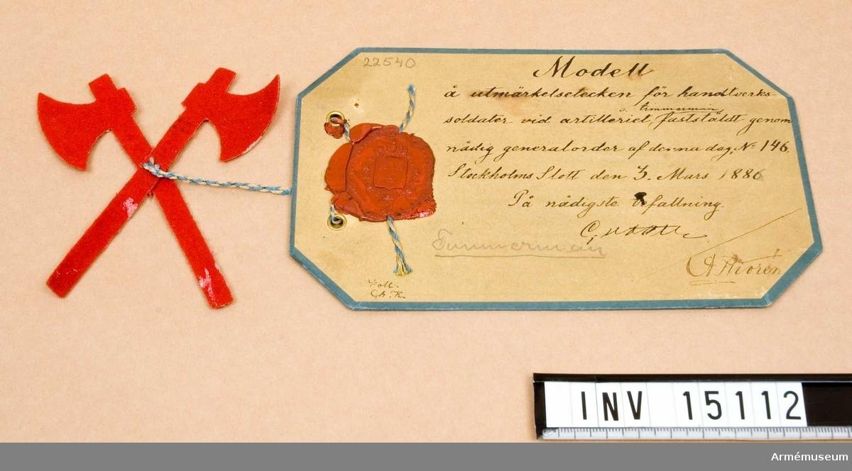 Grupp C I.  Modell å utmärkelsetecken för hantverkssoldater vid artilleriet och timmermän, fastställd genom nådig go nr 146 den 1880-03-03.