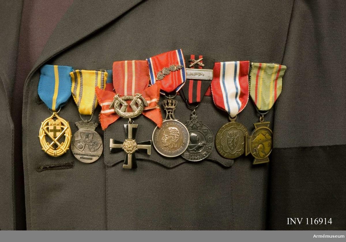 Med sju medaljer.