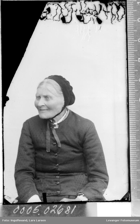 Portrett av en eldre kvinne med lue.