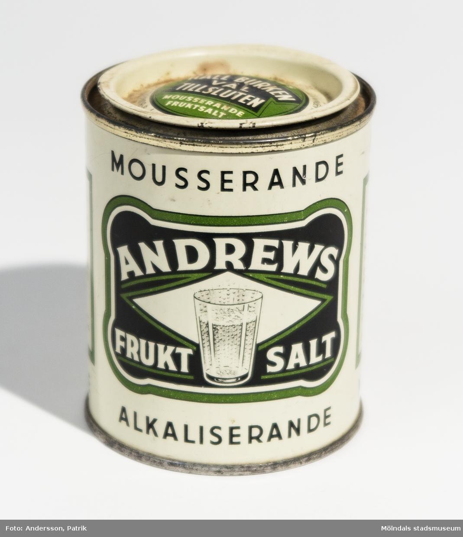 Plåtburk med tillhörade lock som har innehållit Andrews fruktsalt. Burken är tom.