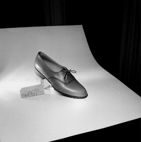 En sko.Oscaria Skofabrik.