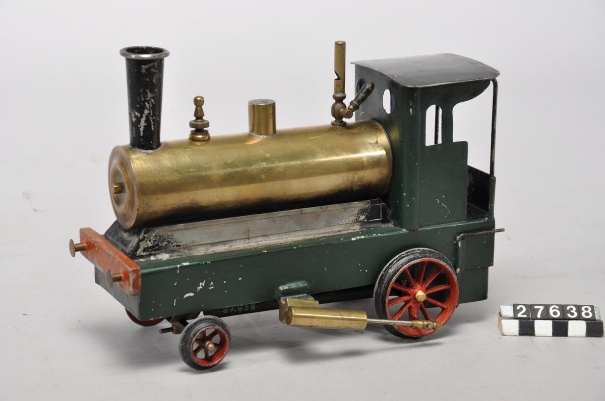 Ånglok med tender, spårvidd 95 mm, oscillerande cylindrar, jämte tender, mått: loket L-280mm, B-132mm, H-187mm, vikt-1,0kg, grön/röd. Tendern: L-190mm, B-105mm, H-90mm, vkt- 0,3kg , grön/svart. Tillbehör: Lösa delar: lok, spritlampa och tender.