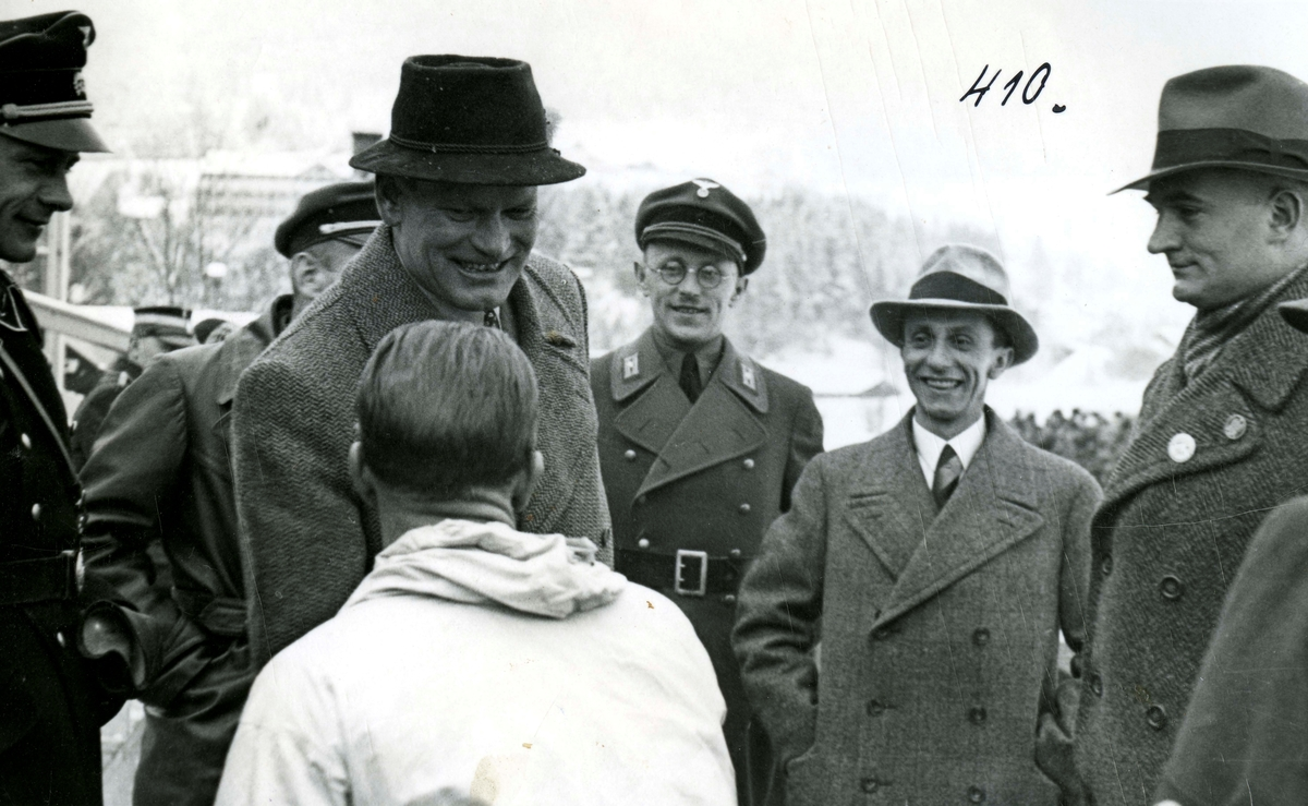 Birger Ruud is greeted by officials at Garmisch