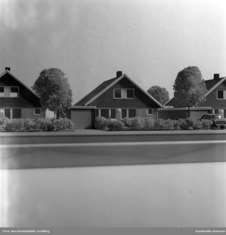 Byggmodell av småhusbebyggelse i Ljustadalen.