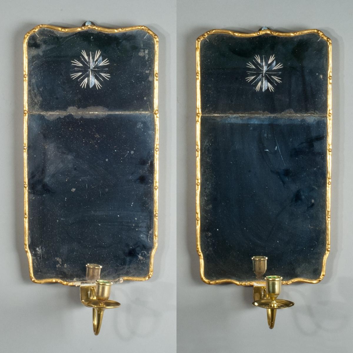 Lampetter, par, av spegelglas med slipad dekor.