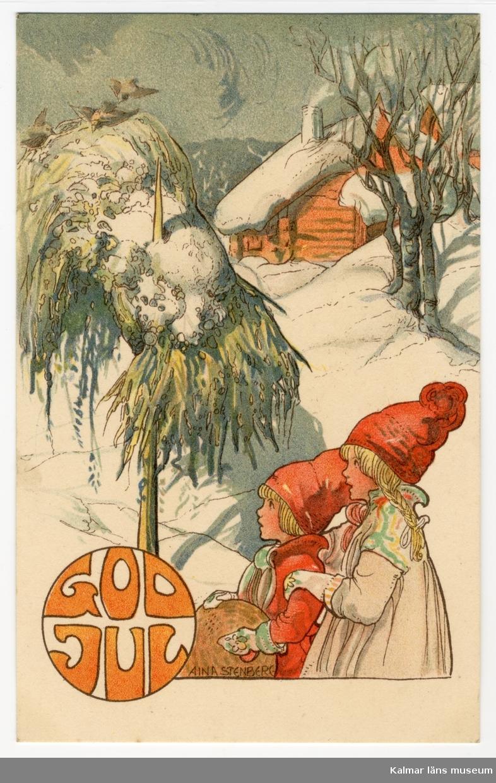 Två flickor står ute i snön och tittar på småfåglar i en kärve. I bakgrunden ses ett rött hus, det ryker ur skorstenen.
