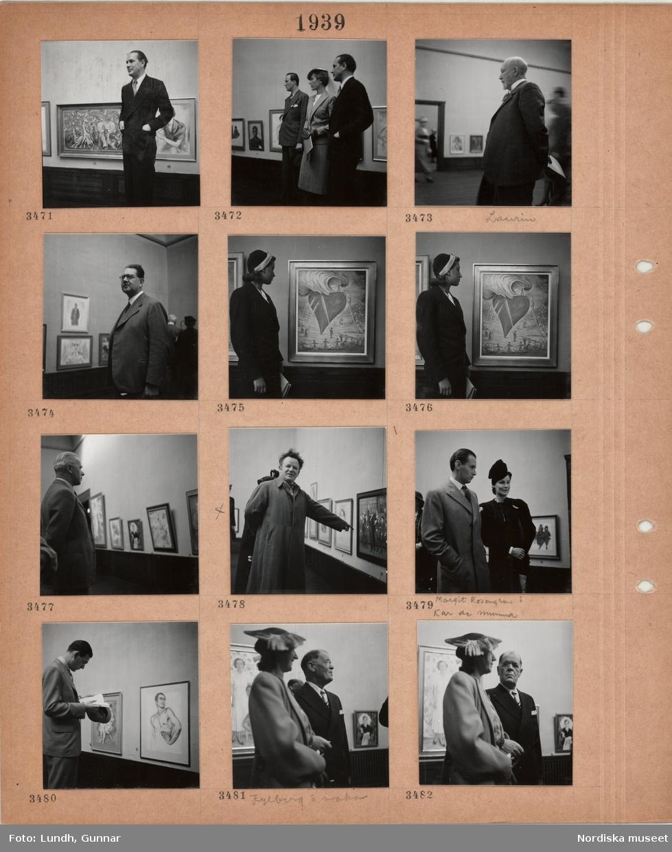 Motiv: Konstutställning, salar med tavlor på väggarna, besökare som tittar på konsten, äldre man, Laurin, ung man, Kar de Mumma, i ytterrock och kvinna, Margit Rosengren, i hatt, man i kostym med dam under armen, Kylberg och maka.