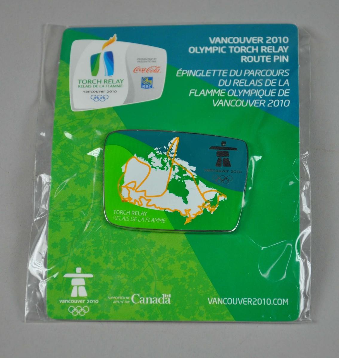 Pins med emblemet for de olympiske vinterleker i Vancouver i 2010. På emblemet er det også motiv av Canada. Pinsen er festet til en plate av papp med logo for Fakkelstafetten i forbindelse med lekene.