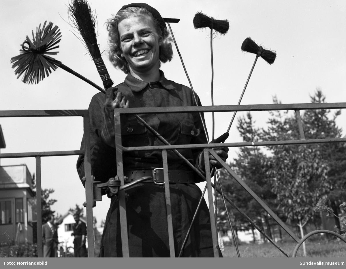 En ung kvinna, Videll, som arbetar som sotare.