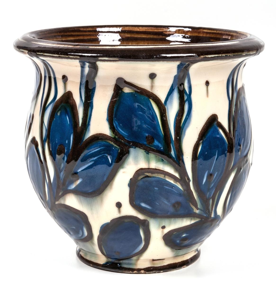 Blomkruka, keramik. Gul botten med blå land och bruna blommor. Stämpel; HAK Danmark.
