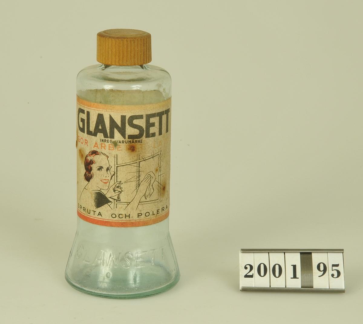 Har innehållit Glansett fönsterputs. Bruksanvisning på etiketten som sitter runt flaskan. Flaskan är utvidgad nertill.