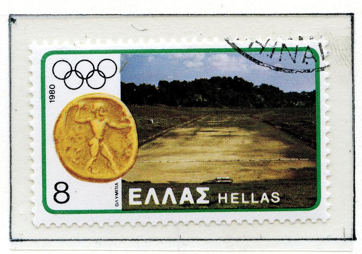 Albumark i A4-størrelse med åtte frimerker - to like som viser portrett av Zevs med med ulik bakgrunnsfarge, to som viser forside og bakside av en mynt med Zevs hode på den ene siden og en falk på den andre siden. De fire nederste frimerkene viser bilder av Olympiastadion, det første en tegning av anlegget slik man antok det så ut, de tre andre viser ruinene med trær i bakgrunnen.