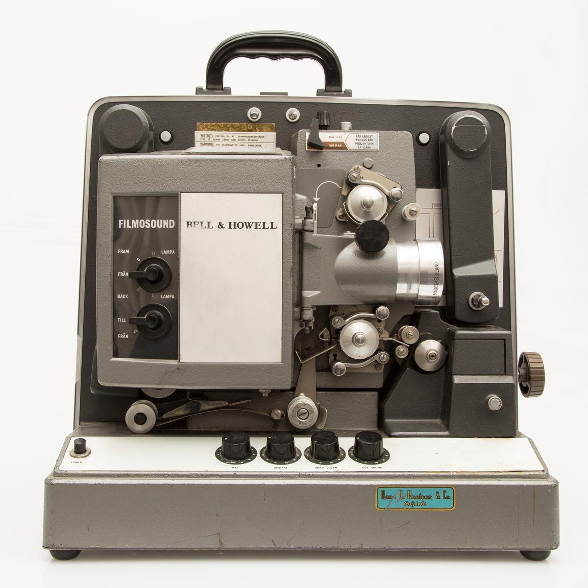 Filmframviser fra Bell & Howell, Filmosound 16 mm projector, med avtagbar høyttaler som fungerer som lokk til framviserkassen. Det følger med et ekstra lokk med høyttaler.