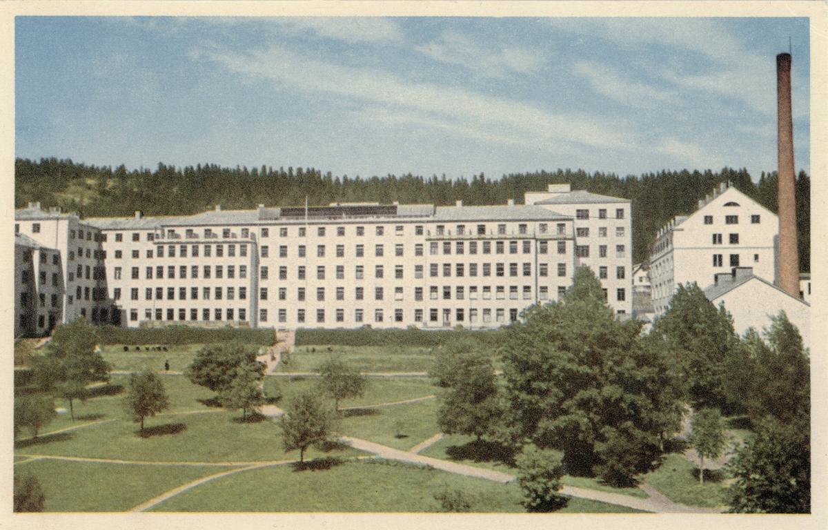 Vy över Sundsvalls länslasarett. Rastrerat vykort. Poststämplat 1957.