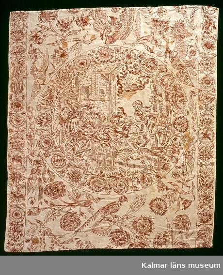 Bibliskt motiv med Maria och Josef med barnet samt herdarna, Herdarnas tillbedjan. Kring cirkeln är flera fåglar och växter, t.ex. nejlikor och rosor broderade. Längs långsidorna broderade bårder med blommor.