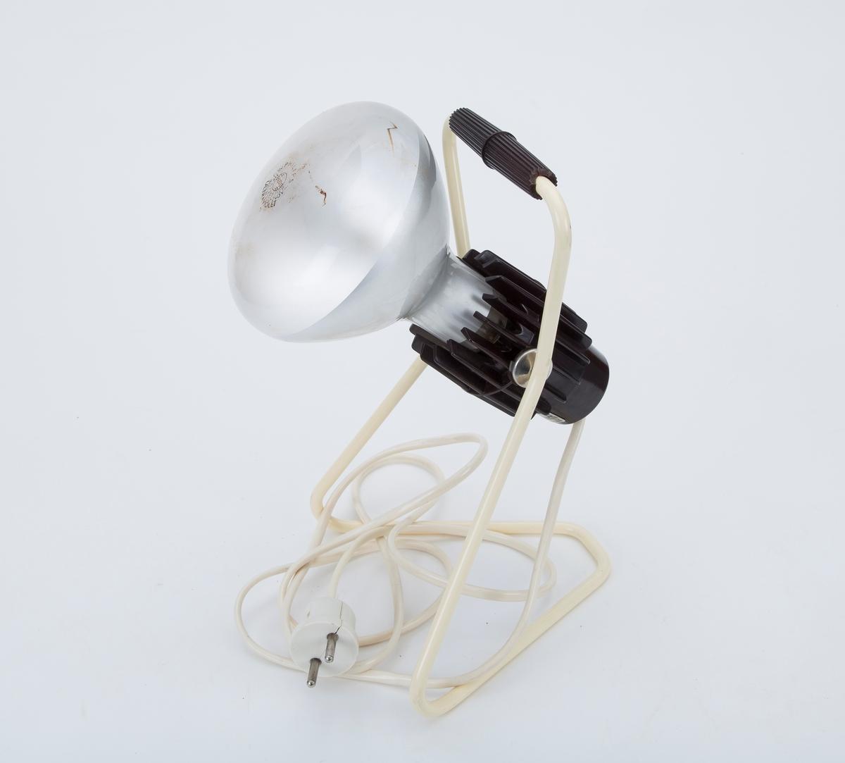 Lampe med UV-pære for kunstig soling. Ligger i originaleske med prislapp kr. 95.