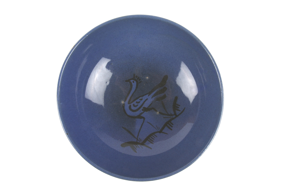 Blå bolle med sort dekor