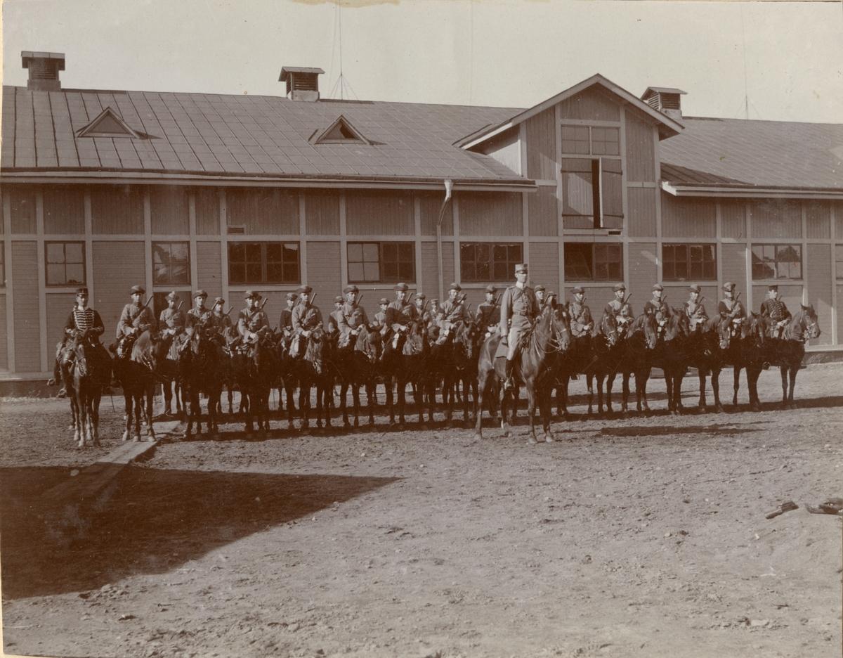 Fotoalbum innehållande bilder från Carl Bernadotte af Wisborgs tid vid Kavalleriskolan i Umeå åren 1909-10 samt diverse familjebilder.