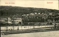 Vykort med motiv över Selångersån och Norrmalm i Sundsvall.