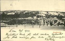 Vykort med vintermotiv över Norrmalm i Sundsvall.