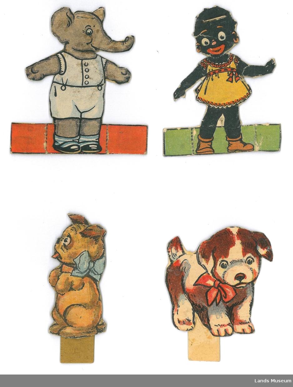 Hund, elefant, mørkhudet dukke.