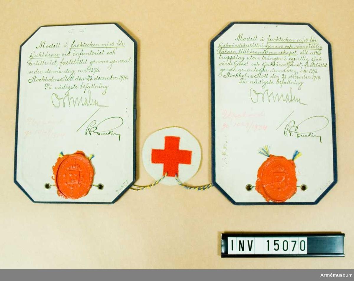 Grupp C I.  Modell å facktecken m/1910 för sjukvårdsbeställningsman och värnpliktig läkare, tillhörande manskapet, vid alla truppslag utom trängen i egentlig sjukvårdstjänst, samt för sjukbärare vid infanteriet och artilleriet, fastställt genom go nr 1376 den 23. december 1910. Upphävd genom go nr 1029/1934.