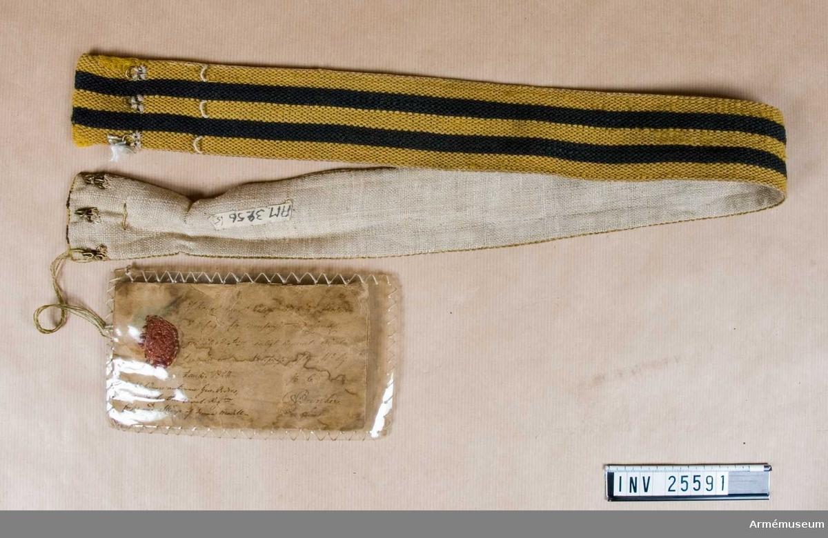 Grupp C I. Ur uniform för manskap vid Västerbottens reg; 1838-1845. Består av jacka, byxa, mössa, skärp, patronkök, bandolär. Enligt go 11/9 1824, armén allmänt. Modellapp.