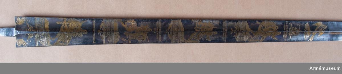 Grupp D II. Klingan är tvåeggad, blånad med ornering av förgylld etsning, allegoriskt syftande på den kejserliga segern vid Nördlingen 1634. På klingans ena sida bild av själva slaget, på dessa andra ryttarporträtt av Ferdinand III, Maximilian I av Bayern, ärke- hertig Leopold Vilhelm och Johan de Werth. Tillverkad i Solingen år 1637-48 av Peter Munich.