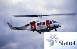 Helikopter i luften ved Statfjord C. Dette er N31853 Bell 2