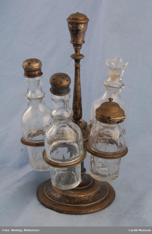 """Form: rund holder m/plass til 5 """"krukker.""""/flasker."""