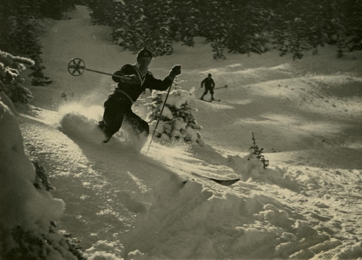 Athlete Birger Ruud doing downhill racing at Garmisch